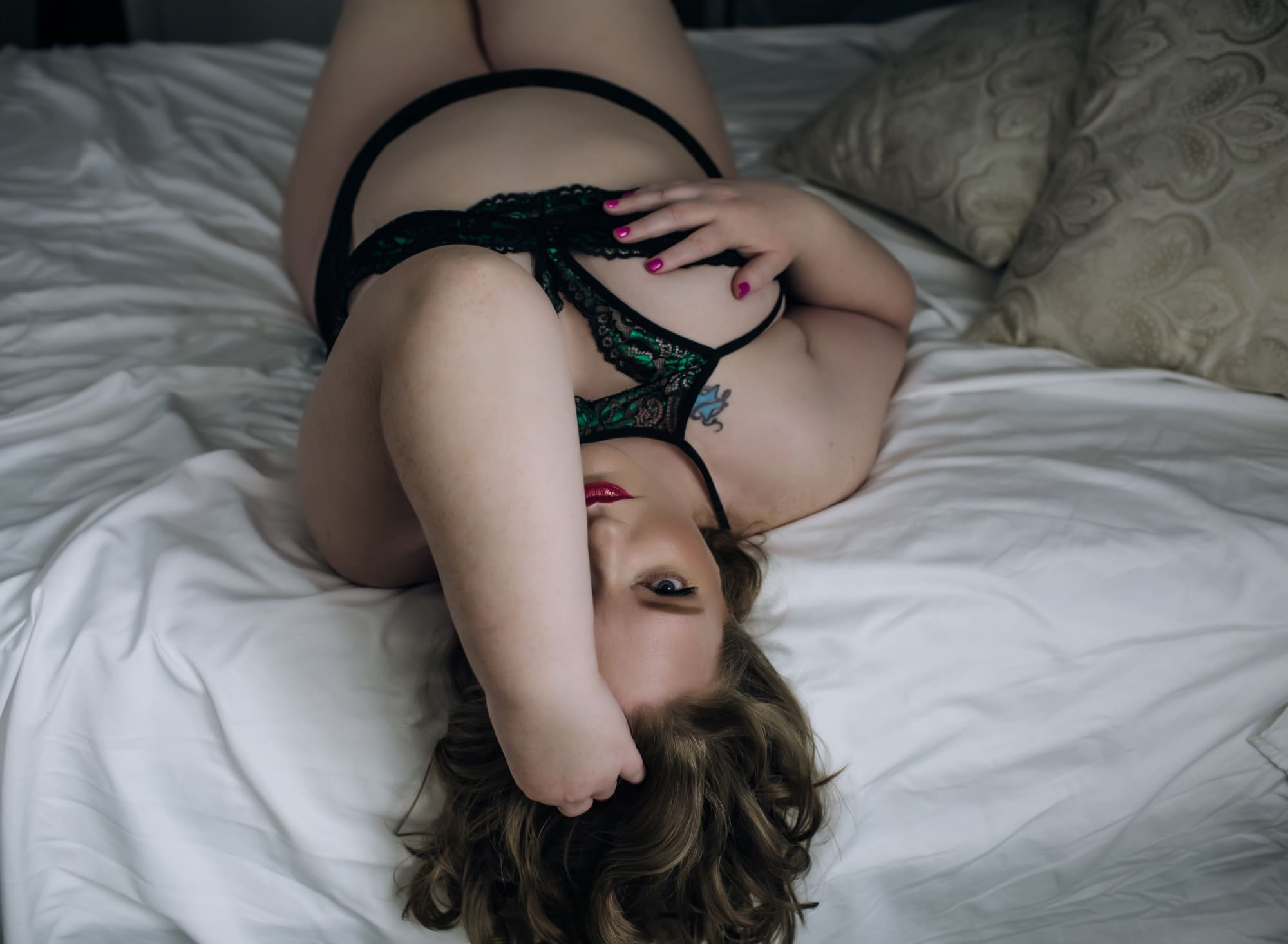 beautiful-woman-laying-on-bed-covering-one-eye