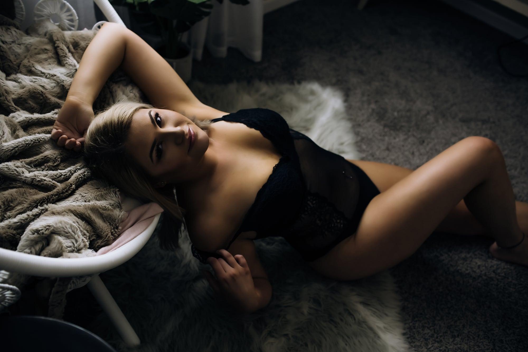 woman-in-black-bodysuit-staring-into-camera